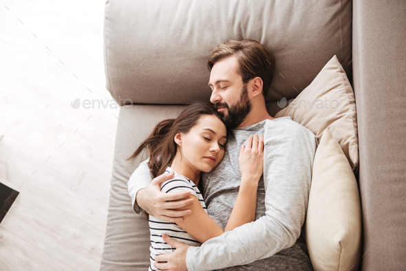 Portrait of an attractive young couple sleeping together